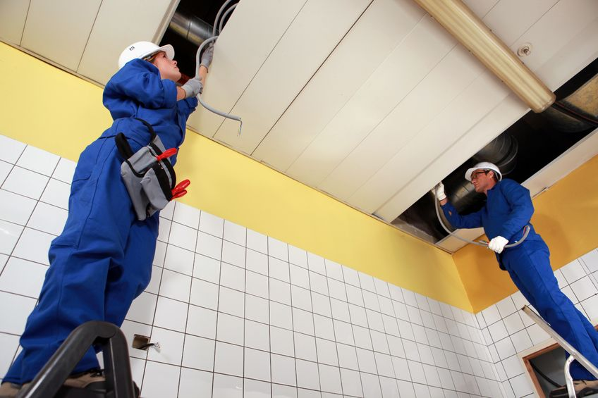 jcpelectric-two electricians repairing ceiling wiring